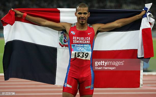 Felix Sanchez of the Dominican Republic celebrates after he won gold the men's 400 metre hurdle final on August 26 2004 during the Athens 2004 Summer...