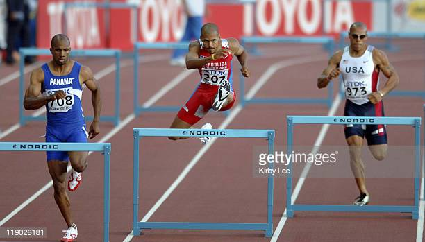Felix Sanchez of the Dominican Republic leads Bayano Kamani of Panama and James Carter of the United States down the backstretch of men's 400meter...