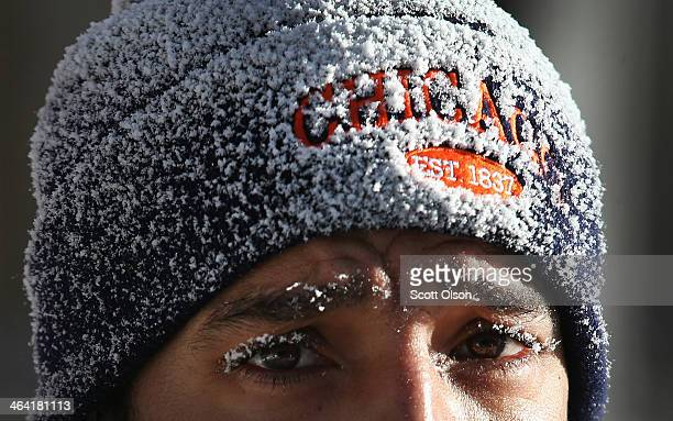 Felix Santos clears snow from a sidwalk in the Humboldt Park neighborhood on January 21 2014 in Chicago Illinois A weather system moved through the...