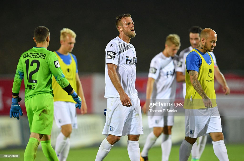 Felix Schiller (C) of Magdeburg looks dejected after the Third League match between FSV Zwickau and 1. FC Magdeburg at Stadion Zwickau on September 1, 2016 in Zwickau, Germany.