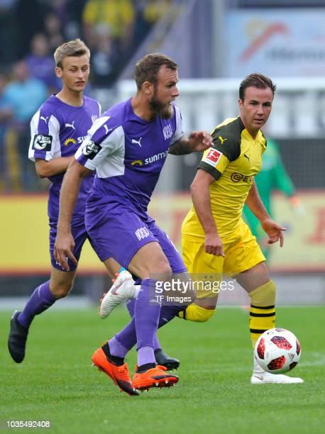 Felix Schiller of Osnabrueck and Mario Goetze of Borussia Dortmund battle for the ball during the Frendly Match between VfL Osnabrück and Borussia...