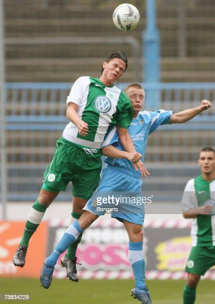 Felix Schimmel of Chemnitzer FC is challenged by Jan Christian Meier of Wolfsburg during the DFB Juniors German Cup semi final Match between...