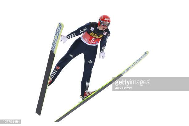 Felix Schoft of Germany competes during the training round for the FIS Ski Jumping World Cup event at the 59th Four Hills ski jumping tournament at...