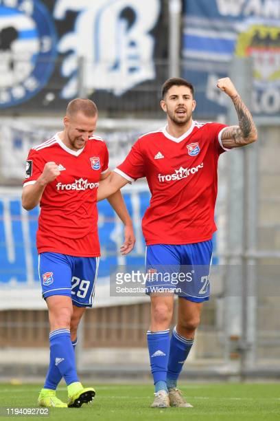 Felix Schroeter and Moritz Heinrichof Unterhaching celebrate after their team's first goal during the 3. Liga match between SpVgg Unterhaching and...