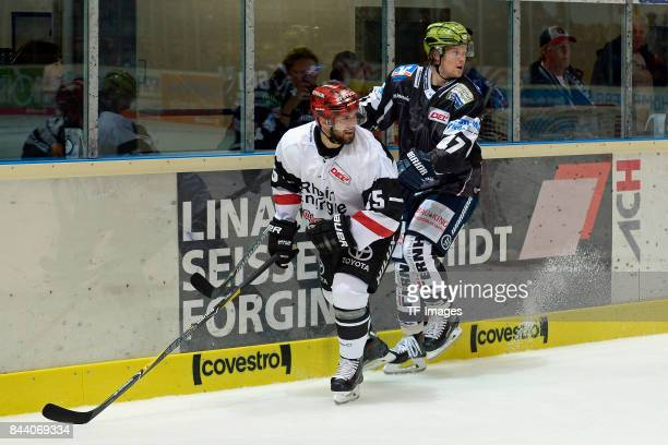 Felix Schütz of Koeln and Alexander Bonsaksen of Iserlohn battle for the ball during a friendly match between Iserlohn Roosters and Koelner Haie on...