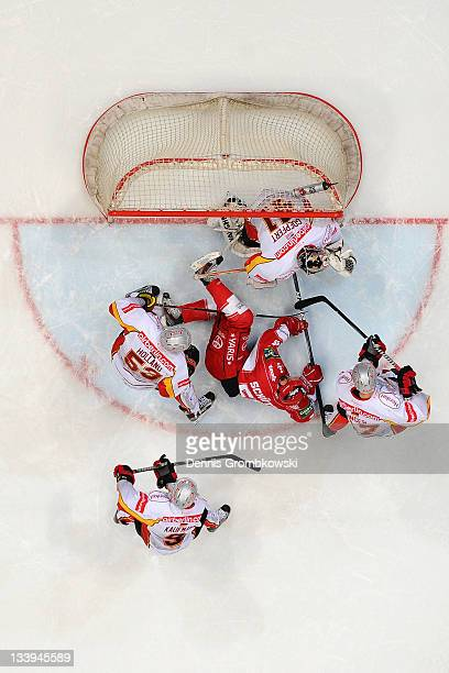 Felix Schuetz of Cologne fails to score during the DEL match between Koelner Haie and DEG Metro Stars at Lanxess Arena on November 22 2011 in Cologne...