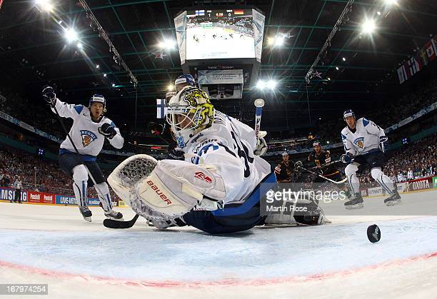 Felix Schuetz of Germany scores his team's equalizing goal over Joni Ortio , goaltender of Finland during the IIHF World Championship group H match...