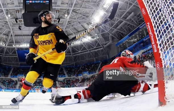 Felix Schutz of Germany celebrates a goal by Matthias Plachta of Germany in the second period against Kevin Poulin of Canada during the Men's...