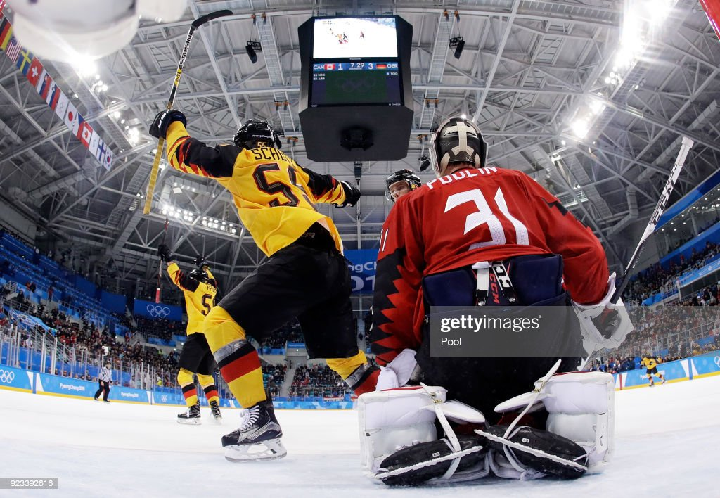 Felix Schutz #55 of Germany celebrates a goal by Patrick Hager #50 of Germany as Kevin Poulin #31 of Canada defends in the second period during the Men's Play-offs Semifinals on day fourteen of the PyeongChang 2018 Winter Olympic Games at Gangneung Hockey Centre on February 23, 2018 in Gangneung, South Korea.