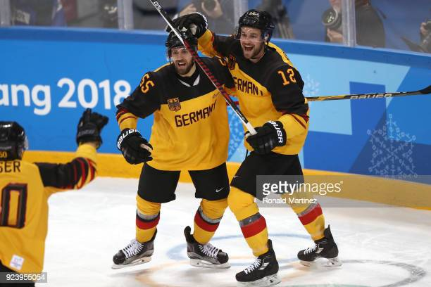 Felix Schutz of Germany celebrates with Brooks Macek after scoring a goal in the second period against Olympic Athletes from Russia during the Men's...