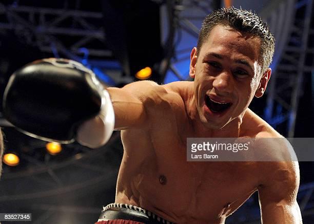 Felix Sturm of Germany celebrates after winning the WBA middleweight world championship fight against Sebastian Sylvester of Germany at the Koenig...