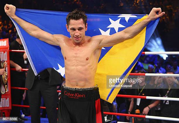 Felix Sturm of Germany celebrates his victory with the flag of Bosnia and Herzegovina after the WBA middleweight world championship fight between...
