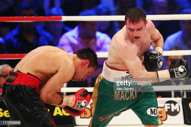 Felix Sturm of Germany is hit by challenger Matthew Macklin of Ireland during their WBA middleweight World Championship fight at Lanxess Arena on...