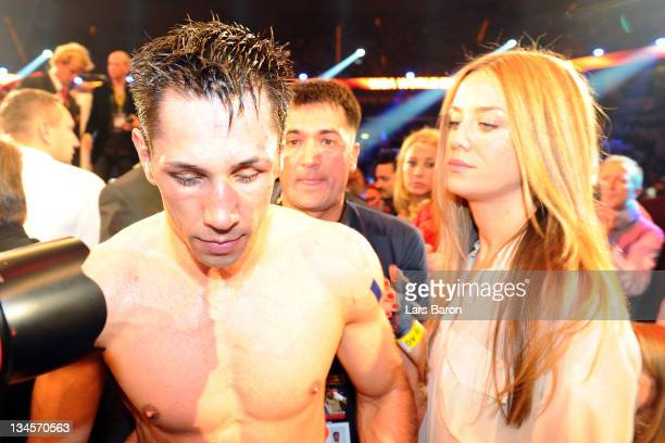 Felix Sturm of Germany is seen with his wife Jasmin after the WBA middleweight championship fight against Martin Murray of Great Britain at SAP arena...