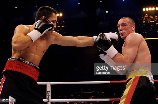 Felix Sturm of Germany punches Sebastian Sylvester of Germany during the WBA middleweight world championship fight at the Koenig Pilsener Arena on...