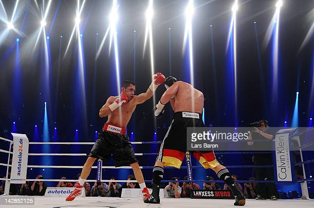 Felix Sturm of Germany punshes Sebastian Zbik of Germany during their WBA World Championship middleweight fight at Lanxess Arena on April 13 2012 in...