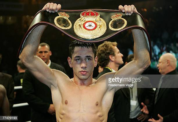 Felix Sturm presents the belt after the WBA Middleweight World Championship fight between Felix Sturm of Germany and Randy Griffin of the USA during...