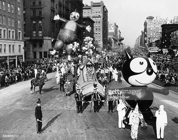 A Felix the Cat balloon and other parade floats and balloons are led down Broadway during the annual Macy's Thanksgiving Day Parade