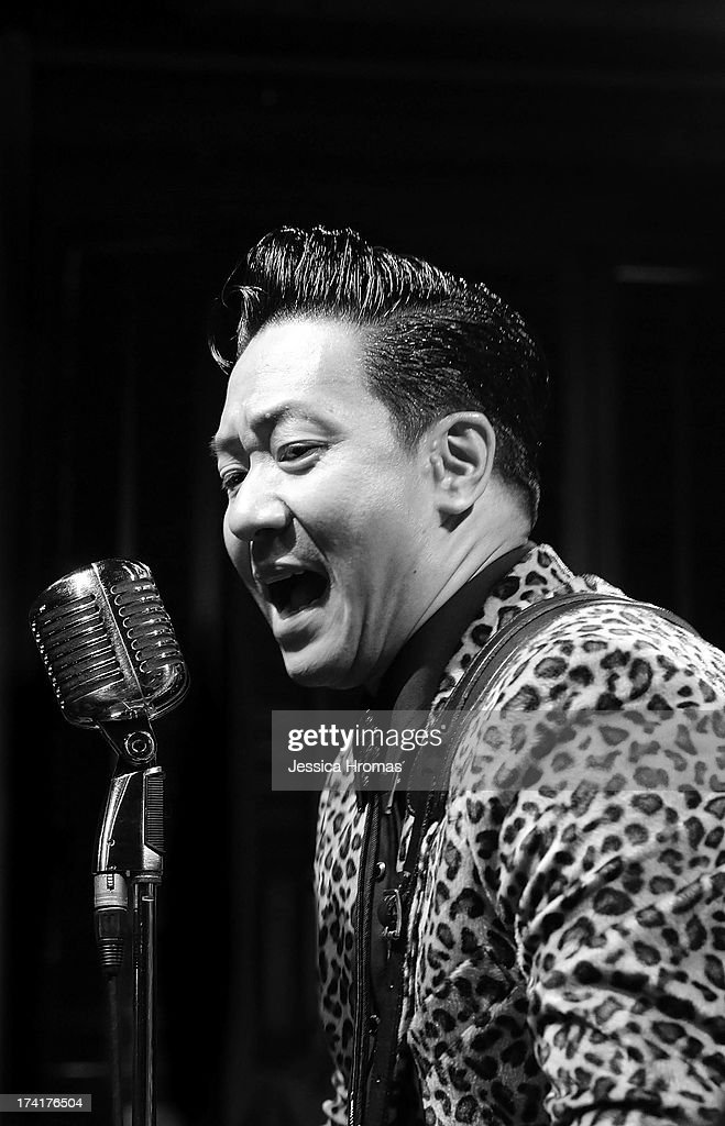 Felix the lead singer of Hong Kong Rockabilly band ' The Boogie Playboys' sings during the Dirty Boogie Rockabilly Festival at the Fringe Club on July 20, 2013 in Hong Kong, Hong Kong.