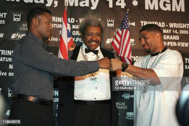 Felix Tito Trinidad and Ronald Winky Wright pose with promoter Don King during a press conference at the Copacabana in NYC announcing upcoming...