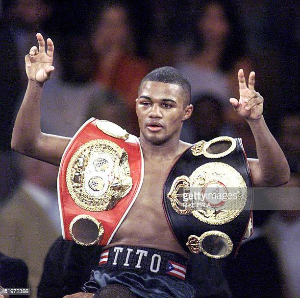 Felix Trinidad of Puerto Rico flashes the Vsign as he wears the championship belts after defeating MexicanAmerican Fernando Vargas in a 12round...