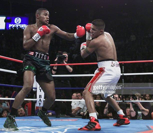 Felix Trinidad of Puerto Rico leads with a left against Mexican-American Fernando Vargas in the third round of their WBA/IBF Super Welterweight...