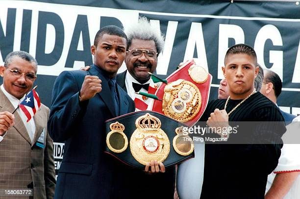 Felix Trinidad Promoter Don King and Fernando Vargas pose with their belts as they promote their upcoming fight in December 2000