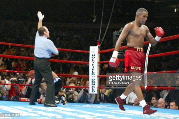 Felix Trinidad walks to his corner as Ricardo Mayorga is counted out at Madison Square Garden In an explosive display of power Trinidad scored an...