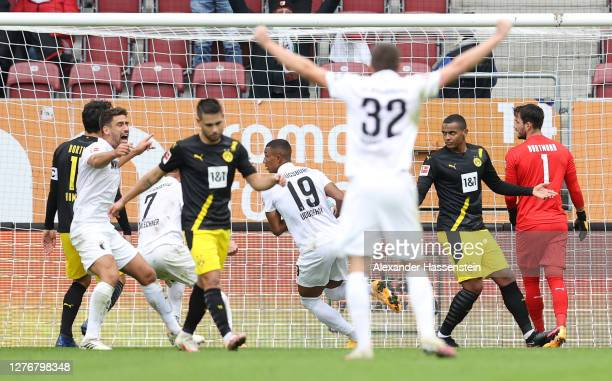 Felix Uduokhai of FC Augsburg celebrates after scoring his team's first goal during the Bundesliga match between FC Augsburg and Borussia Dortmund at...