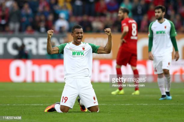 Felix Uduokhai of FC Augsburg celebrates at full time during the Bundesliga match between FC Augsburg and FC Bayern Muenchen at WWK-Arena on October...