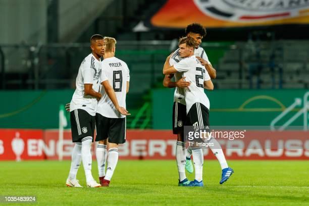 Felix Uduokhai of Germany Arne Maier of Germany Aaron Seydel of Germany and Pascal Stenzel of Germany celebrates after winning the U21 International...