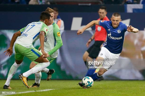 Felix Uduokhai of VfL Wolfsburg Fabian Reese of Schalke 04 during the German Bundesliga match between Schalke 04 v VFL Wolfsburg at the Veltins Arena...