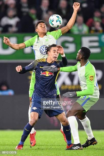 Felix Uduokhai of VfL Wolfsburg Yussuf Poulsen of RB Leipzig and Josuha Guilavogui of VfL Wolfsburg battle for the ball during the Bundesliga match...