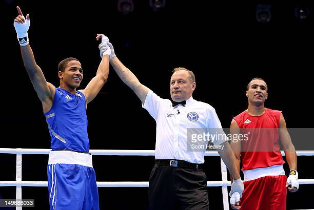 Felix Verdejo Sanchez of Puerto Rico celebrates his victory over Ahmed Mejri of Tunisia during the Men's Light on Day 6 of the London 2012 Olympic...