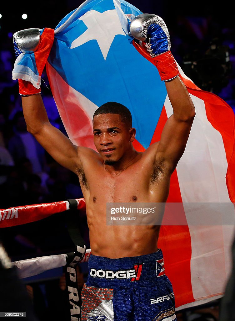 Felix Verdjo celebrates with the Puerto Rican flag after defeating Juan Jose Martinez in the fifth round on a TKO in of their Lightweight bout on June 11, 2016 at the Theater at Madison Square Garden in New York City.