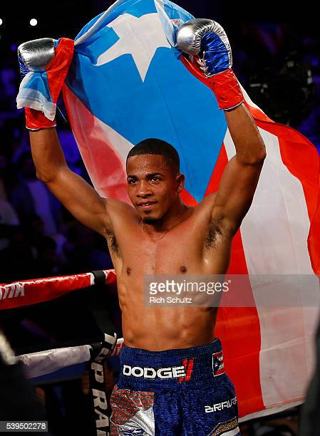 Felix Verdjo celebrates with the Puerto Rican flag after defeating Juan Jose Martinez in the fifth round on a TKO in of their Lightweight bout on...