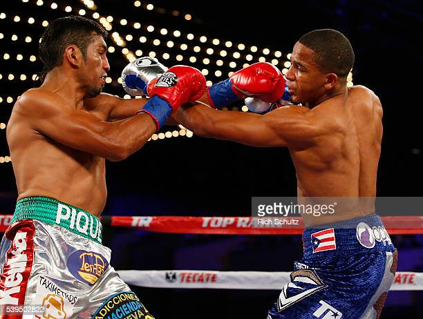 Felix Verdjo right trades punches with Juan Jose Martinez during their Lightweight bout on June 11 2016 at the Theater at Madison Square Garden in...