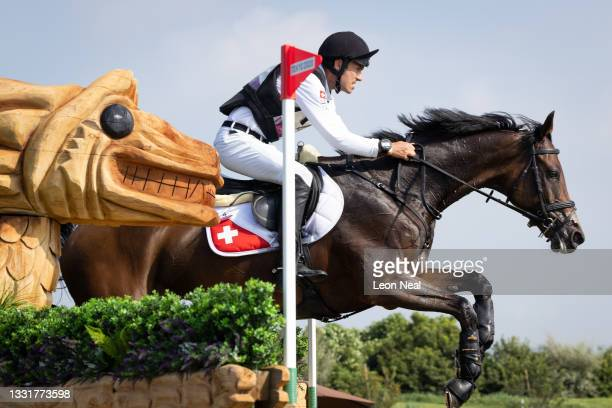 Felix Vogg of Team Switzerland riding Colero clears a jump during the Eventing Cross Country Team and Individual on day nine of the Tokyo 2020...