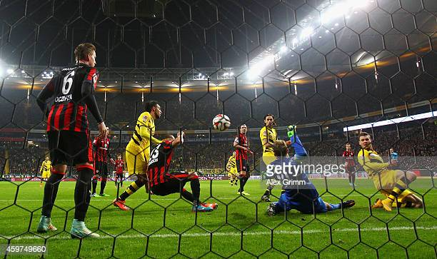 Felix Wiedwald of Eintracht Frankfurt does a save as PierreEmerick Aubameyang Neven Subotic and Lukasz Piszczek of Borussia Dortmund miss a chance at...