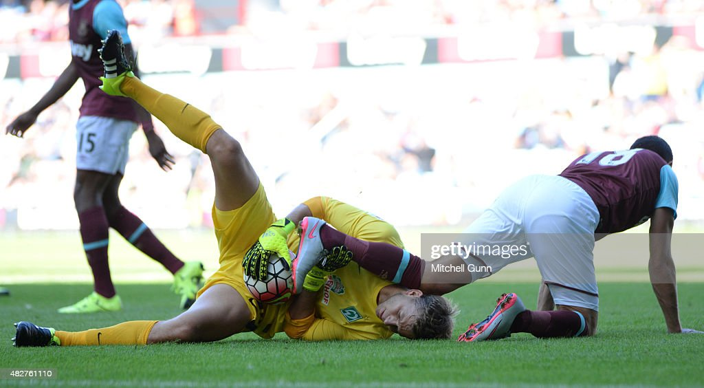 Felix Wiedwald of Werder Bremen and Morgan Amalfitano of West Ham during the Betway Cup match between West Ham United and Werder Bremen at Boleyn Ground on August 2, 2015 in London, England.