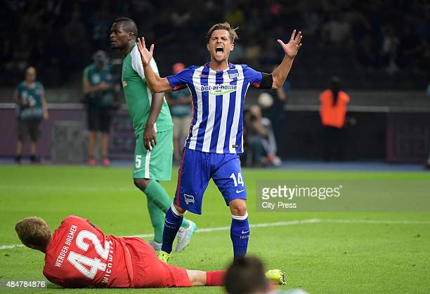 Felix Wiedwald of Werder Bremen and Valentin Stocker of Hertha BSC during the game between Hertha BSC and Werder Bremen on August 21 2015 in Berlin...