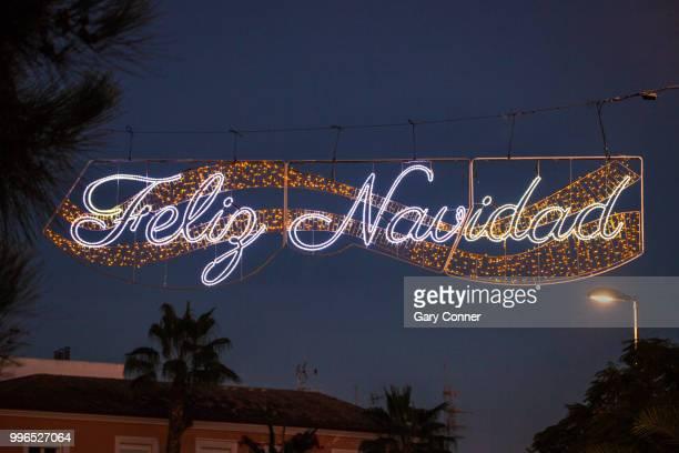 feliz navidad, holiday lighting at dusk - feliz navidad stock photos and pictures