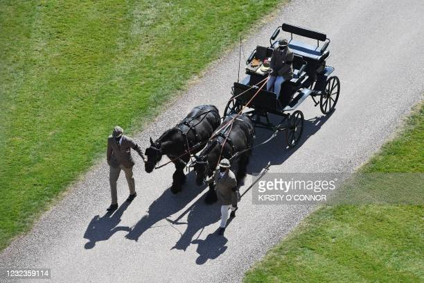 Fell ponies, Balmoral Nevis and Notlaw Storm pullling the Duke of Edinburgh's driving carriage arrive at Windsor Castle in Windsor, west of London,...