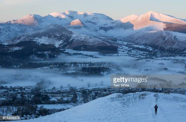 A fell runner makes his way over Latrigg at dawn on February 7 2018 near Keswick England Freezing conditions are continuing with forecasters...
