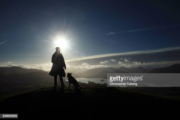 Fell walker enjoys the panoramic views from on top of Latrigg in the Lakeland Fells on December 4, 2009 in Keswick, England. After being cut off by...