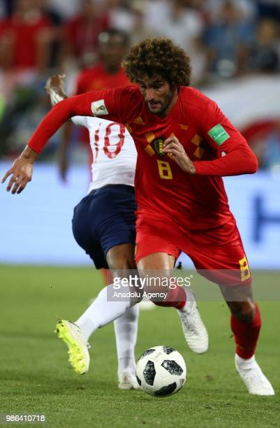 Fellaini of Belgium in action against Raheem Sterling of England during 2018 FIFA World Cup Russia Group G match between England and Belgium at the...