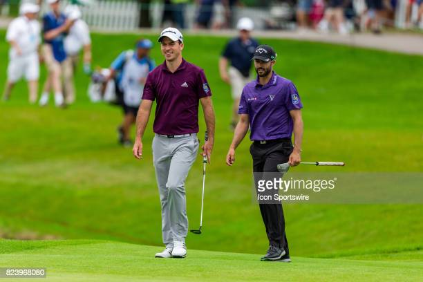 Fellow Canadians Nick Taylor and Adam Hadwin walk onto the green during first round action of the RBC Canadian Open on July 27 at Glen Abbey Golf...