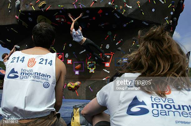 Fellow climbers watch as Max Zolotukhin of Gainesville, Florida climbs one of the problems presented during the Pro Bouldering Qualifier during The...