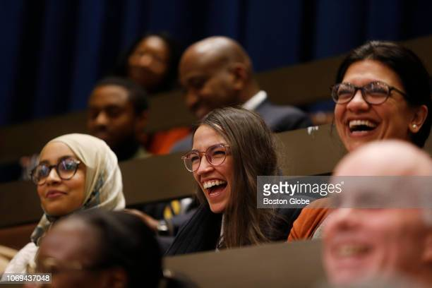 Fellow congresswomenelect Alexandria OcasioCortez center and Rashida Tlaib right laugh as City Councilors referenced them in their farewell speech to...