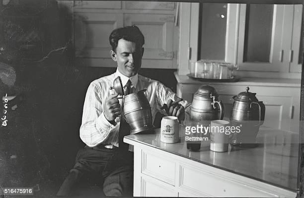 Fellow drinking from stein in a Havana bar room